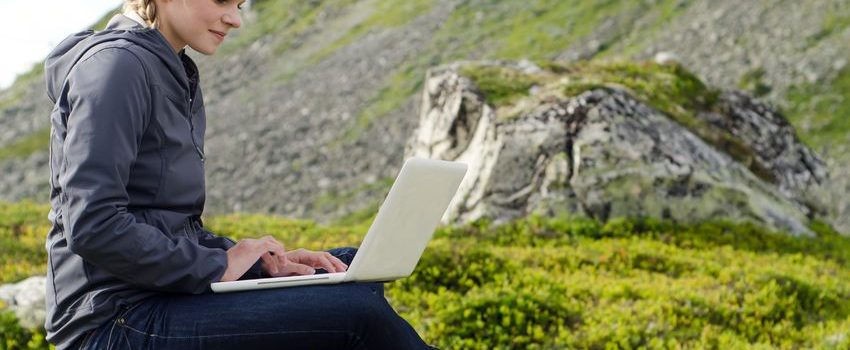 Woman outdoors on laptop